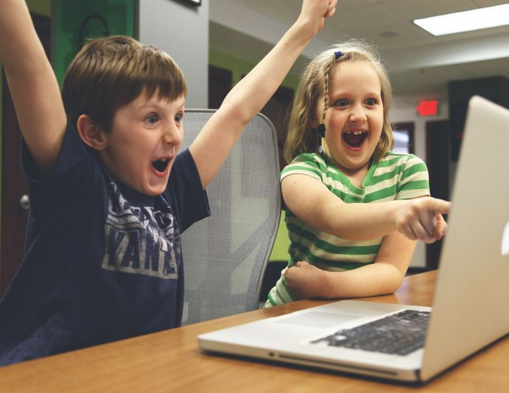 Two kids screaming at the computer