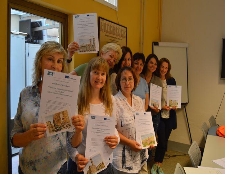 Teachers showing their TEFL certificate