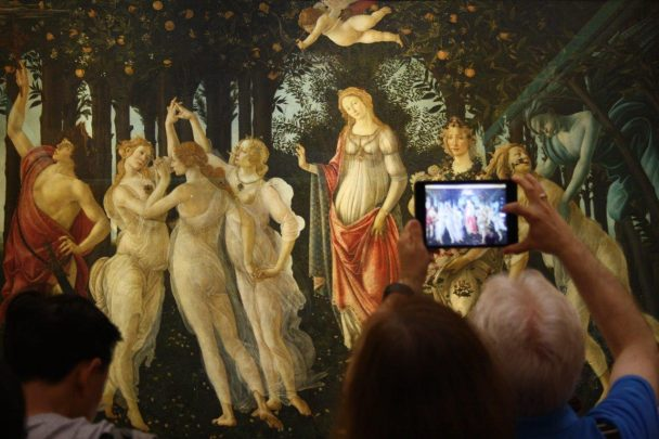 phone in front of botticelli's painting